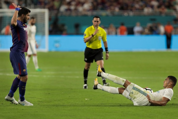 Barcelona forward Luis Suarez, left, puts his hands in the air after a foul called against him on Real Madrid midfielder Casemiro, right, Saturday night at Hard Rock Stadium. Randy Vazquez, South Florida Sun-Sentinel