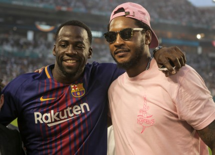 NBA stars Draymond Green, left, and Carmelo Anthony, right, show up to watch the game versus Real Madrid and Barcelona at Hard Rock Stadium. Randy Vazquez, South Florida Sun-Sentinel