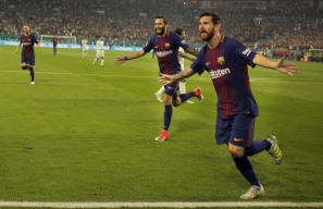 Barcelona's Lionel Messi celebrates after scoring the opening goal of the match versus rival Real Madrid Saturday night at Hard Rock Stadium. Randy Vazquez, South Florida Sun-Sentinel