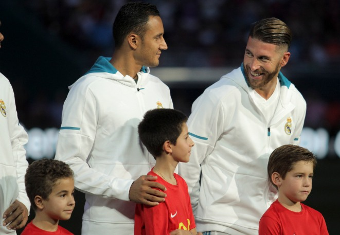 Real Madrid goalie Keylor Navas, left, talks with teammate Sergio Ramos, right, prior to their game versus rival Barcelona at Hard Rock Stadium. Randy Vazquez, South Florida Sun-Sentinel