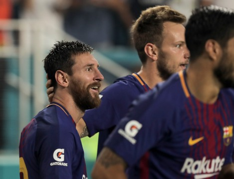 Barcelona's Lionel Messi smiles after scoring the opening goal of the match versus rival Real Madrid Saturday night at Hard Rock Stadium. Randy Vazquez, South Florida Sun-Sentinel