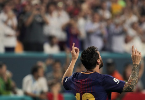 Barcelona's Lionel Messi does his signature celebration by pointing at the sky after scoring the opening goal of the match versus rival Real Madrid Saturday night at Hard Rock Stadium. Randy Vazquez, South Florida Sun-Sentinel