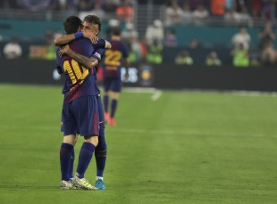 Barcelona's Lionel Messi is hugged by teammate Neymar after scoring the opening goal of the match versus rival Real Madrid Saturday night at Hard Rock Stadium. Randy Vazquez, South Florida Sun-Sentinel