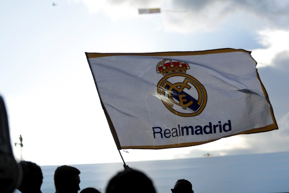 A fan waves a Real Madrid flag prior to the game versus Barcelona game at Hard Rock Stadium on Saturday, July 29, 2017. Randy Vazquez, South Florida Sun-Sentinel