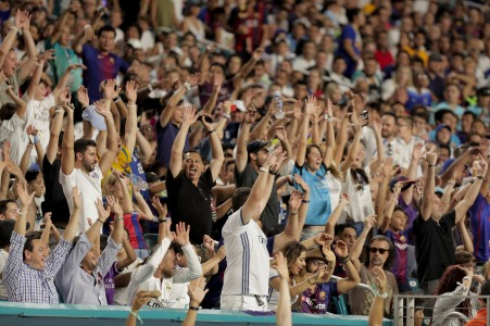 Fans do the wave Saturday night during the Real Madrid versus Barcelona game at Hard Rock Stadium. Randy Vazquez, South Florida Sun-Sentinel