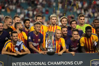 Barcelona poses with the trophy presented to them after defeating rival Real Madrid Saturday at Hard Rock Stadium. Randy Vazquez, South Florida Sun-Sentinel