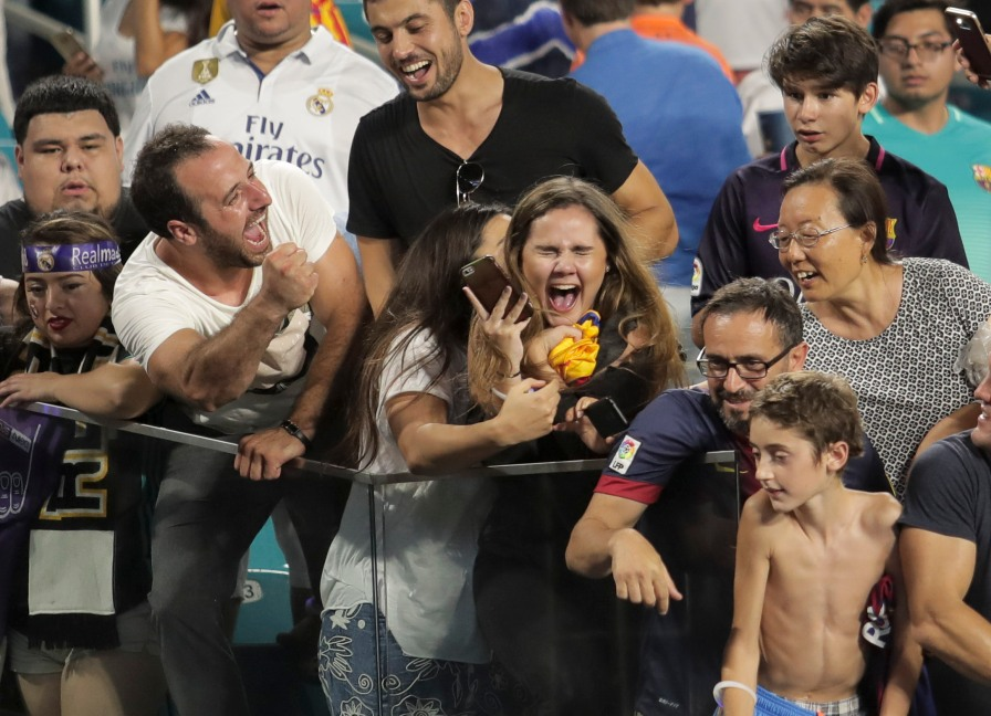 A fan gets emotional after receiving Ivan Rakitic's jersey Saturday at Hard Rock Stadium. Randy Vazquez, South Florida Sun-Sentinel