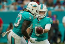 Miami Dolphins quarterback Jay Cutler (6), right, hands the ball off to running back Jay Ajayi (23), left, during Thursday night's game versus the Baltimore Ravens at Hard Rock Stadium. Randy Vazquez, South Florida Sun-Sentinel