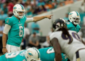 Miami Dolphins quarterback Jay Cutler (6), left, calls out a play during Thursday night's game versus the Baltimore Ravens at Hard Rock Stadium. Randy Vazquez, South Florida Sun-Sentinel