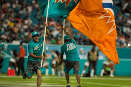 A man runs with a Miami Dolphins flag during the game versus the Baltimore Ravens on Thursday, Aug. 17, 2017. Randy Vazquez, South Florida Sun-Sentinel