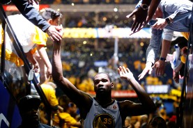 Golden State Warriors' Kevin Durant (35) gives fans high fives after his team defeated the San Antonio Spurs 99-91 in Game 5 of the NBA first-round playoff series at Oracle Arena in Oakland, Calif., on Tuesday, April 24, 2018. (Randy Vazquez/Bay Area News Group)