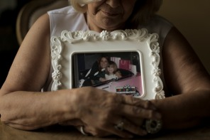 Jo-Ann Bruno hugs a picture of her the sister Nancy Bochicchio and niece Joey Bochicchio-Hauser in her home in West Boca Raton on Tuesday, July 25, 2017. Almost a decade ago, Nancy and her 7-year-old daughter were found dead in the family's Chrysler Aspen SUV, which was found in the Town Center of Boca Raton mall parking lot