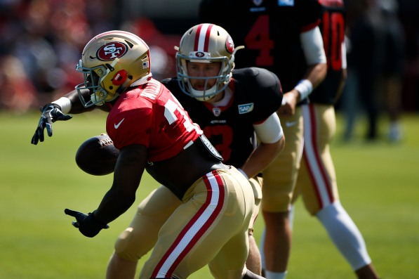 San Francisco 49ers' running back Joe Williams (32), left, receives a handoff from quarterback C.J. Beathard (3), right, during training camp at the teams' practice facility in Santa Clara, Calif., on Tuesday, July 31, 2018. (Randy Vazquez/ Bay Area News Group)