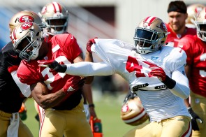 San Francisco 49ers' running back Matt Breida (22), left, tries to block linebacker Elijah Lee (47), right, during training camp at the teams' practice facility in Santa Clara, Calif., on Tuesday, July 31, 2018. (Randy Vazquez/ Bay Area News Group)