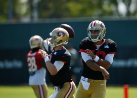 San Francisco 49ers' quarterback Jimmy Garoppolo (10), right, and quarterback C.J. Beathard (3), left, throw passes during training camp at the teams' practice facility in Santa Clara, Calif., on Tuesday, July 31, 2018. (Randy Vazquez/ Bay Area News Group)