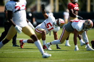 San Francisco 49ers' linebacker Malcolm Smith (51), center, stretches during training camp at the teams' practice facility in Santa Clara, Calif., on Tuesday, July 31, 2018. (Randy Vazquez/ Bay Area News Group)