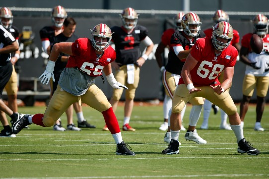 San Francisco 49ers' tackle Mike McGlinchey (69), left, and teammate offensive lineman Mike Person (68), right, run a play during training camp at the teams' practice facility in Santa Clara, Calif., on Tuesday, July 31, 2018. (Randy Vazquez/ Bay Area News Group)