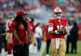 San Francsico 49ers' Richard Sherman (25), left, and quarterback Jimmy Garoppolo (10), right, smile before their preseason NFL game versus the Dallas Cowboys at Levi's Stadium in Santa Clara, Calif., on Thursday, Aug. 9, 2018. (Randy Vazquez/ Bay Area News Group)
