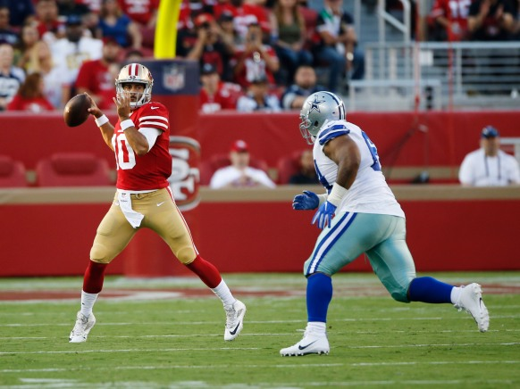 San Francsico 49ers quarterback Jimmy Garoppolo (10), left, throws a pass in the first quarter of their preseason NFL game at Levi's Stadium in Santa Clara, Calif., on Thursday, Aug. 9, 2018. (Randy Vazquez/ Bay Area News Group)