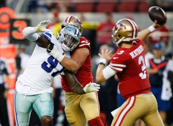 Dallas Cowboys' Taco Charlton (97), left, gets blocked by San Francisco 49ers' Mike McGlinchey (69), center, while quarterback C.J. Beathard (3), right, throws a pass in the second quarter of their preseason NFL game at Levi's Stadium in Santa Clara, Calif., on Thursday, Aug. 9, 2018. (Randy Vazquez/ Bay Area News Group)