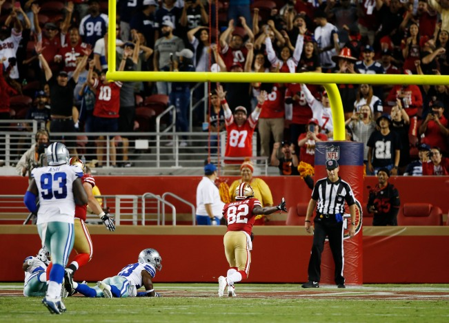 San Francisco 49ers' Richie James Jr. (82) scores a late touchdown to give his team a 22-21 lead with less than a minute left in his teams preseason NFL game versus the Dallas Cowboys at Levi's Stadium in Santa Clara, Calif., on Thursday, Aug. 9, 2018. The 49ers would go one to win the game 24-21 over the Cowboys. (Randy Vazquez/ Bay Area News Group)