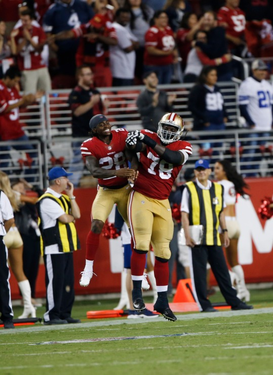San Francisco 49ers' Jerick McKinnon (28), left, and Darrell Williams (78), right, celebrate after their team scores a 2-point conversion in the fourth quarter of their preseason NFL game at Levi's Stadium in Santa Clara, Calif., on Thursday, Aug. 9, 2018. The 49ers would go one to win the game 24-21 over the Dallas Cowboys. (Randy Vazquez/ Bay Area News Group)