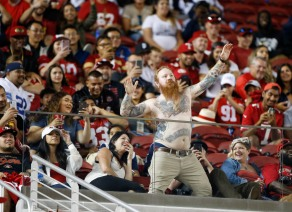 A fan takes of his shirt and dances in the third quarter of the preseason NFL game between the San Francisco 49ers and the Dallas Cowboys at Levi's Stadium in Santa Clara, Calif., on Thursday, Aug. 9, 2018. (Randy Vazquez/ Bay Area News Group)