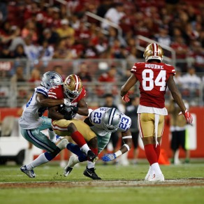 San Francisco 49ers' Joe Williams (32) gets tackled by a pair of Dallas Cowboys defenders in the third quarter of their preseason NFL game at Levi's Stadium in Santa Clara, Calif., on Thursday, Aug. 9, 2018. (Randy Vazquez/ Bay Area News Group)