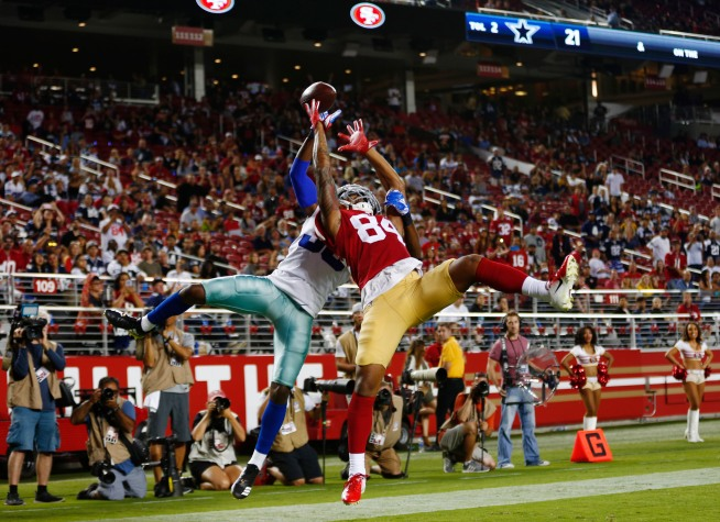 San Francisco 49ers' Kendrick Bourne (84) and Dallas Cowboys' Marquez White (39) jump up for a ball in the endzone in the third quarter of their preseason NFL game at Levi's Stadium in Santa Clara, Calif., on Thursday, Aug. 9, 2018. (Randy Vazquez/ Bay Area News Group)