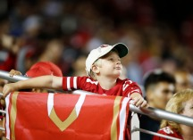 A young San Francisco 49ers fan looks up at the big screen in the fourth quarter his teams preseason NFL game versus the Dallas Cowboys at Levi's Stadium in Santa Clara, Calif., on Thursday, Aug. 9, 2018. (Randy Vazquez/ Bay Area News Group)