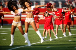 San Francisco 49ers cheerleaders are joined by some young cheerleaders during a pregame before the 49ers preseason NFL game versus the Dallas Cowboys at Levi's Stadium in Santa Clara, Calif., on Thursday, Aug. 9, 2018. (Randy Vazquez/ Bay Area News Group)