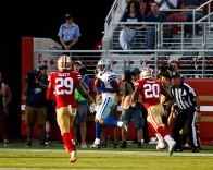 Dallas Cowboys' Michael Gallup (13), center, makes a touchdown catch while covered by San Francisco 49ers' Jimmie Ward (20), right, and Jaquiski Tartt (29), left, in the first quarter of their preseason NFL game at Levi's Stadium in Santa Clara, Calif., on Thursday, Aug. 9, 2018. (Randy Vazquez/ Bay Area News Group)