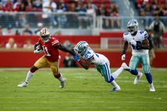 San Francisco 49ers' Marquise Goodwin (11), left, gets away from Dallas Cowboys' Chidobe Awuzie (24), center, in the first quarter of their preseason NFL game at Levi's Stadium in Santa Clara, Calif., on Thursday, Aug. 9, 2018. (Randy Vazquez/ Bay Area News Group)