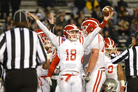 Mater Dei's Jonathan Daniels (18) celebrates after running in for his teams' second touchdown in the first quarter of the 2017 CIF State Football Championship Open Division Bowl Game at Sacramento State University in Sacramento, Calif. on Saturday, Dec. 16, 2017. (Randy Vazquez/Bay Area News Group)
