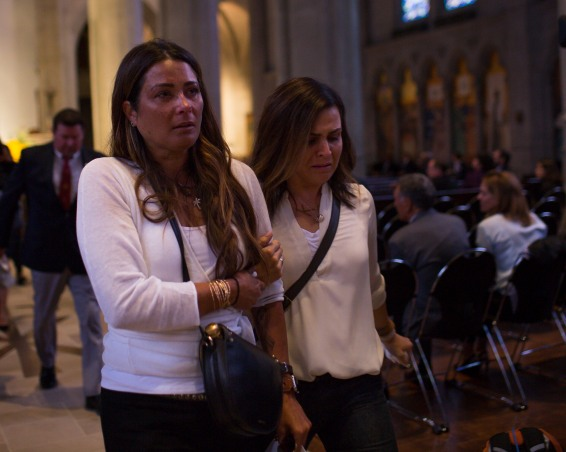 Kelly Radzikowski, left, the wife of San Francisco 49ers great Dwight Clark exits Grace Cathedral in San Francisco on Wednesday, Aug. 1, 2018. A private memorial service was held for Clark which was attended by his family, former teammates and some local leaders. (Randy Vazquez/ Bay Area News Group)