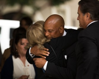 NFL Hall of Fame member Ronnie Lott, center, was one of many former teammates of San Francisco 49ers' great Dwight Clark who attended a private memorial service for Clark at Grace Cathedral in San Francisco on Wednesday, Aug. 1, 2018. At right is former head coach Steve Mariucci. (Randy Vazquez/ Bay Area News Group)