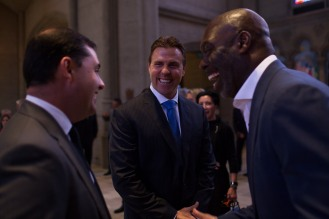 San Francisco 49ers CEO Jed York, left, and former NFL player Bill Romanowski, center, smile after a private memorial service for 49ers great Dwight Clark at Grace Cathedral in San Francisco on Wednesday, Aug. 1, 2018. (Randy Vazquez/ Bay Area News Group)