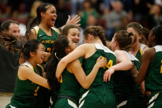 Pinewood players celebrate after winning in the CIF NorCal Open Division girls championship game at Leavey Center in Santa Clara, Calif. on Saturday, March 17, 2018. Pinewood would win the game 78-67 over Archbishop Mitty. (Randy Vazquez/ Bay Area News Group)