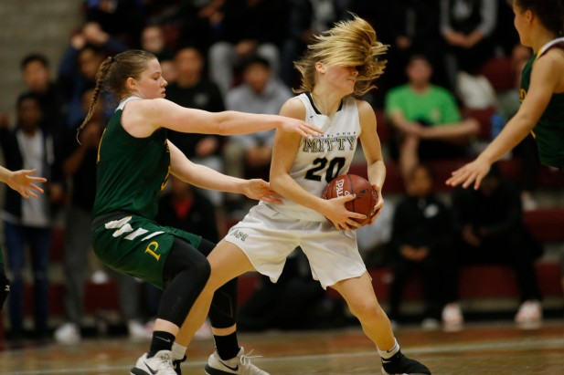 Archbishop Mitty's Hunter Hernandez (20), right, tries to keep the ball from Pinewood's Klara Astrom (11), left, in the third quarter of the CIF NorCal Open Division girls championship game at Leavey Center in Santa Clara, Calif. on Saturday, March 17, 2018. (Randy Vazquez/ Bay Area News Group)