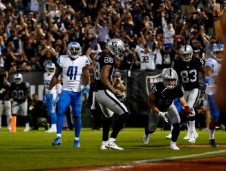 Oakland Raiders' Ryan Switzer (15) gets up to celebrate after scoring his teams first touchdown of the game in the first quarter of their preseason NFL game Detroit Lions at the Coliseum in Oakland, Calif., on Friday, Aug. 10, 2018. (Randy Vazquez/ Bay Area News Group)