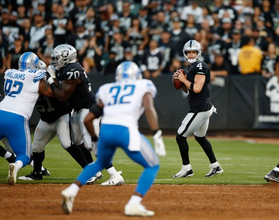 Oakland Raiders quarterback Derek Carr (4) throws a pass in the first quarter of their preseason NFL game versus the Detroit Lions at the Coliseum in Oakland, Calif., on Friday, Aug. 10, 2018. (Randy Vazquez/ Bay Area News Group)
