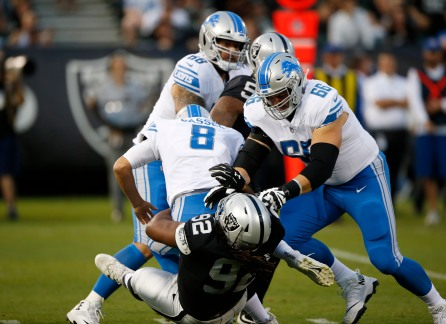 Oakland Raiders' P.J. Hall (92), sacks Detroit Lions quarterback Matt Cassel (8) in the first quarter of their preseason NFL game at the Coliseum in Oakland, Calif., on Friday, Aug. 10, 2018. (Randy Vazquez/ Bay Area News Group)