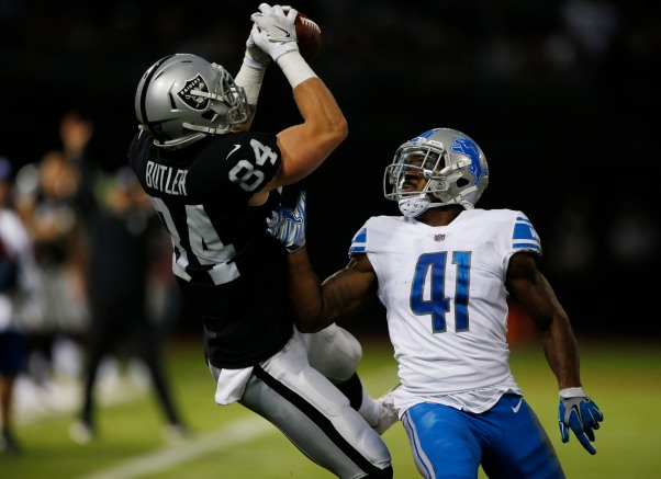 Oakland Raiders' Paul Butler (84), left, catches a pass from Detroit Lions' Rolan Milligan (41), right, in the second quarter of their preseason NFL game at the Coliseum in Oakland, Calif., on Friday, Aug. 10, 2018. (Randy Vazquez/ Bay Area News Group)