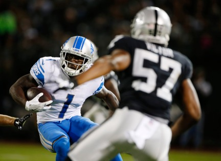 Detroit Lions' Brandon Powell (1), left, tries to get away from Oakland Raiders' Azeem Victor (57), right, in the fourth quarter of their preseason NFL game at the Coliseum in Oakland, Calif., on Friday, Aug. 10, 2018. The Raiders would win the game 16-10 over the Lions. (Randy Vazquez/ Bay Area News Group)