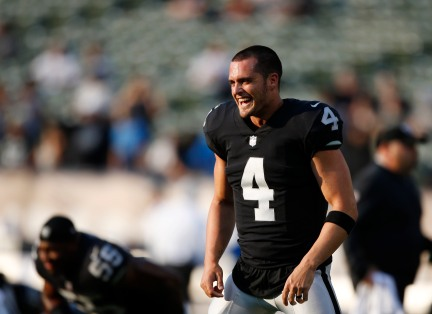 Oakland Raiders quarterback Derek Carr (4) smiles while stretching before his teams preseason NFL game versus the Detroit Lions at the Coliseum in Oakland, Calif., on Friday, Aug. 10, 2018. (Randy Vazquez/ Bay Area News Group)