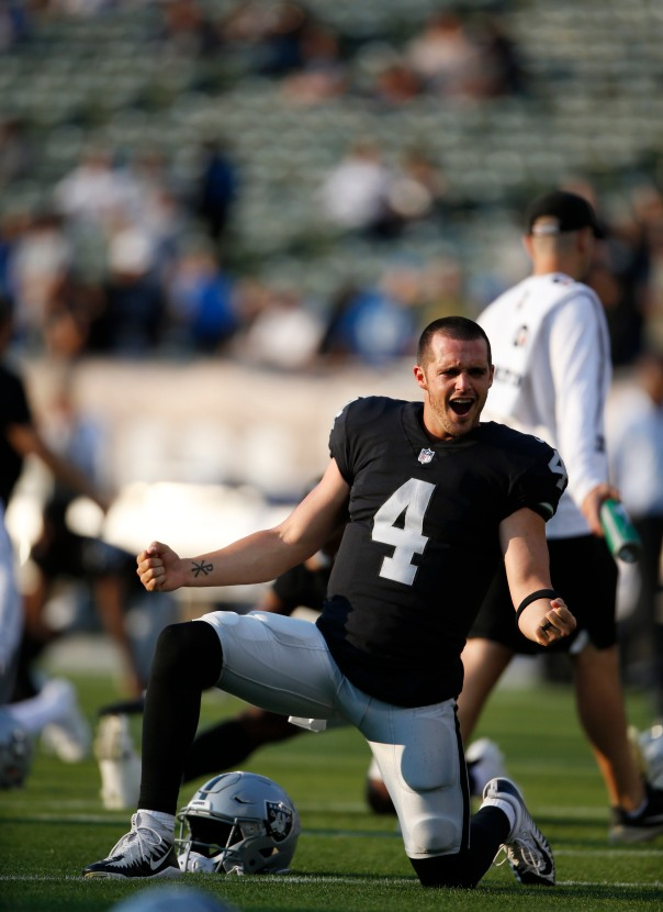 Oakland Raiders quarterback Derek Carr (4), has some fun with his teammates while stretching before their preseason NFL game versus the Detroit Lions at the Coliseum in Oakland, Calif., on Friday, Aug. 10, 2018. (Randy Vazquez/ Bay Area News Group)