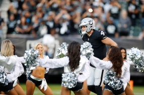 Oakland Raiders quarterback Derek Carr (4) runs out of the tunnel before his teams preseason NFL game versus the Detroit Lions at the Coliseum in Oakland, Calif., on Friday, Aug. 10, 2018. (Randy Vazquez/ Bay Area News Group)