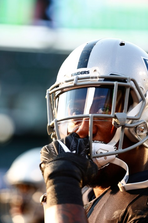 Oakland Raiders' Bruce Irvin (51) looks up at the crowd before his teams preseason NFL game versus the Detroit Lions at the Coliseum in Oakland, Calif., on Friday, Aug. 10, 2018. (Randy Vazquez/ Bay Area News Group)