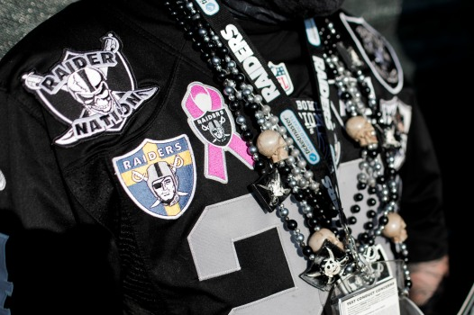 Patches and chains cover Timothy Klein's jersey at the Oakland Raiders preseason NFL game at the Coliseum in Oakland, Calif., on Friday, Aug. 10, 2018. Klein goes by Raider Timbo and he dresses from head to toe in Raiders gear. (Randy Vazquez/ Bay Area News Group)