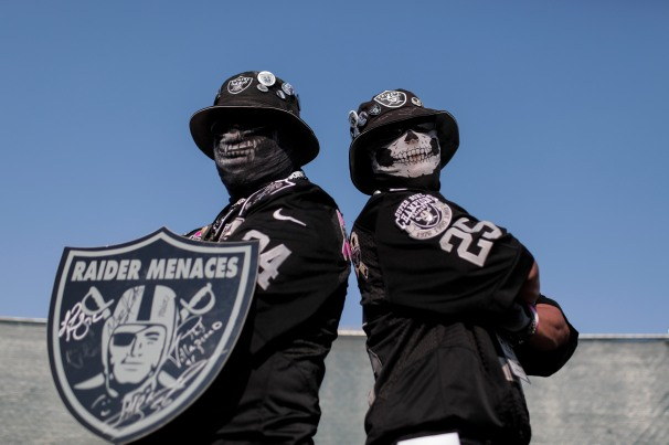Timothy Klein, left, and Gabriel Nanez, right, show up to the Oakland Raiders preseason NFL game at the Coliseum in Oakland, Calif., on Friday, Aug. 10, 2018. The pair also known as Raider Timbo and Raider Gabe are dressed from head to toe in their teams' colors. (Randy Vazquez/ Bay Area News Group)
